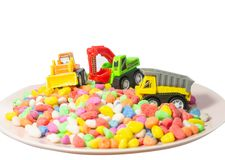 Tree truck toy on multi colors little stone stock image