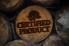 Tree trunks with logo branding certified product