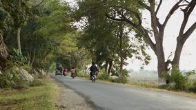 Tree tunnel road in Bagan, Myanmar. Many vehicles run on tree tunnel road in Bagan, Myanmar stock footage