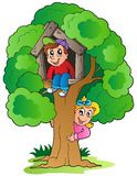 Tree with two cartoon kids Royalty Free Stock Photo