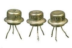 Tree vintage electronic transistors. Isolated on white background Stock Photos