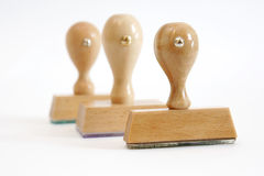 Tree wooden rubber stamps in a row Royalty Free Stock Photo