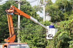 Tree Worker evaluating the job from a bucket truck. Removing branches - what out for that electric line Royalty Free Stock Image