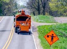 Tree workers in an orange work truck Stock Photo