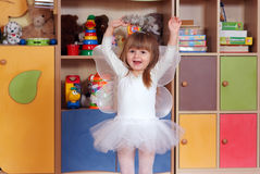 Tree-year girl playing and learning in preschool Stock Image
