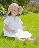 Tree years old girl in the garden Royalty Free Stock Photo