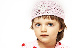 Tree years old girl with knitted cap Stock Photos