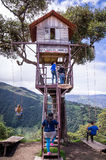 Treehouse giant swing in the Andes in Banos Ecuador. Banos, Ecuador on November 18, 2015: Tourists enjoying the giant swing at the treehouse Casa del Arbol in Royalty Free Stock Photography
