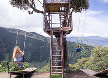 Treehouse giant swing in the Andes in Banos Ecuador. Banos, Ecuador on November 18, 2015: Tourists enjoying the giant swing at the treehouse Casa del Arbol in Stock Image