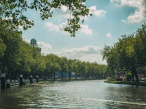 Trees along the canal. Trees along a curved canal in Delft, Holland Royalty Free Stock Image