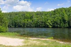 Trees along the shore of Lake Marburg, at Codorus State Park, Pennsylvania. Royalty Free Stock Photo