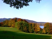Landscape panorama with mountains and lake in autumn colors. Trees with autumnal foliage, mountain lake in the background, hiking holiday in southern Germany Stock Photos