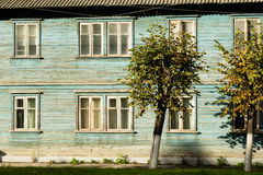 Trees on a background of a wooden house stock photo