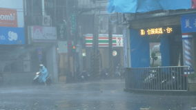 Trees blowing in surge of typhoon Wind and Rain. New Taipei City, Taiwan.  September 27, 2016: Trees blowing in surge of typhoon Wind and Rain in city streets stock footage