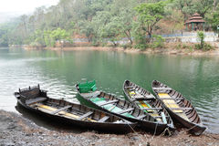 Trees and boat on the bank of Sattal lake Stock Images