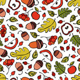 Trees, branches, leaves. Berries and apples. Acorns. Seamless vector pattern background. Stock Images