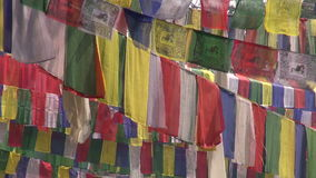 Trees with Buddhist praying flags. Buddha birthplace in Lumbini, Nepal Stock Photo