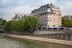 Trees and buildings are on Embankment of Seine in Paris Stock Photography