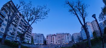 Trees and buildings. A picture of trees and buildings and a blue sky,in a summer day  afternoon,in a town in Greece.Thessaloniki Royalty Free Stock Photo