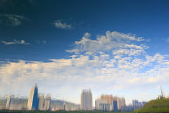 Trees and buildings reflecting in a lake Royalty Free Stock Photo
