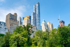 Trees in Central Park with of the midtown Manhattan skyline in New York. Trees in Central Park with a view of the Central Park South skyline in midtown Manhattan royalty free stock photography