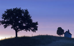 Trees and chapel at sunset Royalty Free Stock Photos