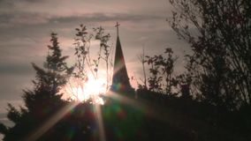 Trees with church in background. Silhouette. stock video