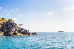 Trees on cliff, blue sky with cloud, Nam Du islands Stock Image