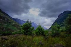 Trees and clouds, Ben Nevis range. Dark clouds over the Ben Nevis range, Scotland Royalty Free Stock Photography