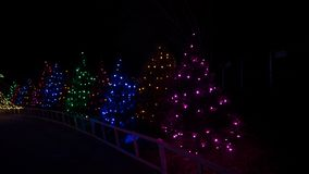 Trees covered in colorful Christmas holiday themed lighting as part of a festival event royalty free stock images