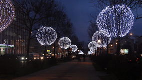 Trees decorated with glowing balls in the evening. Festive Christmas lighting. Trees decorated with large glowing balls in the evening on the boulevard. Festive stock video