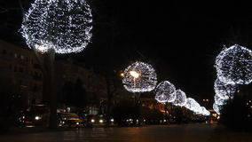 Trees decorated with glowing balls in the evening. Festive Christmas lighting. stock video