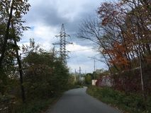 Trees, downward road. Power stations, nature, countryside. Trees, downward asphalt road. Power stations, nature, Vladivostok countryside, early autumn Royalty Free Stock Photography