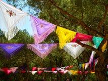 Trees dressed with colorful Manila shawls. Trees dressed with colorful Mantones de Manila Manila shawls in a Flamenco fair. Spanish Yarn bombing royalty free stock photo