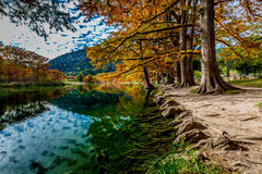 Trees with Fall Foliage Lining the Frio River at Garner State Park. Trees with Beautiful Fall Foliage Lining the Crystal Clear Emerald Green Frio River at Garner stock photography