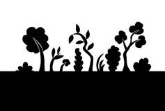 Trees and grass silhouettes Royalty Free Stock Photo