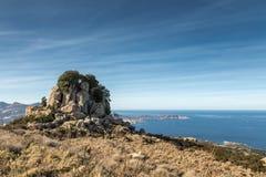 Rocky outcrop above Calvi Bay in Corsica Royalty Free Stock Photo
