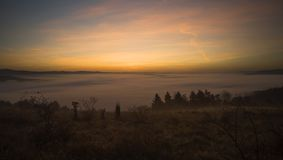 Trees and hills on mountain in the morning. Autumn royalty free stock images