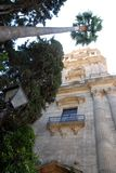 Trees and a historic building in downtown Malaga in Spain Stock Images
