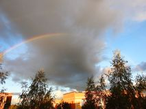 Trees, homes and beautiful rainbow, Lithuania royalty free stock photos