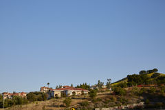 Trees and houses on the mountain Royalty Free Stock Image