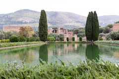 Trees with lake reflection and mountain. At hadrian villa, adriana is a large roman archaeological complex at tivoli, Italy Royalty Free Stock Image
