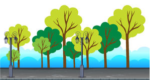 Trees and lamp posts alone the road Royalty Free Stock Photography