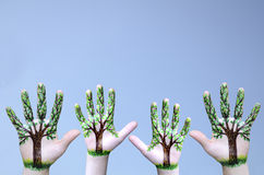 Trees painted on hands Royalty Free Stock Photos