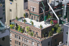 Trees and plants grow on outdoor deck of New York City apartment building in Manhattan, New York Royalty Free Stock Photo