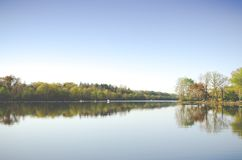 Trees reflecting in lake Stock Photo
