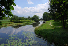 Trees by the river. A water canal on the outskirts of Elburg, The Netherlands Royalty Free Stock Images