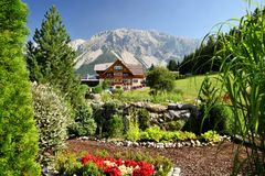 Beautiful garden in ramsau dachstein austria with mauntains in the back stock photos