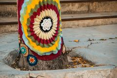 Trees with storm yarn. Decorated with coloured wool. Street Art. Hippie concept stock photos