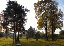 Trees in village. Church in lithuanian village Viesintos Royalty Free Stock Images